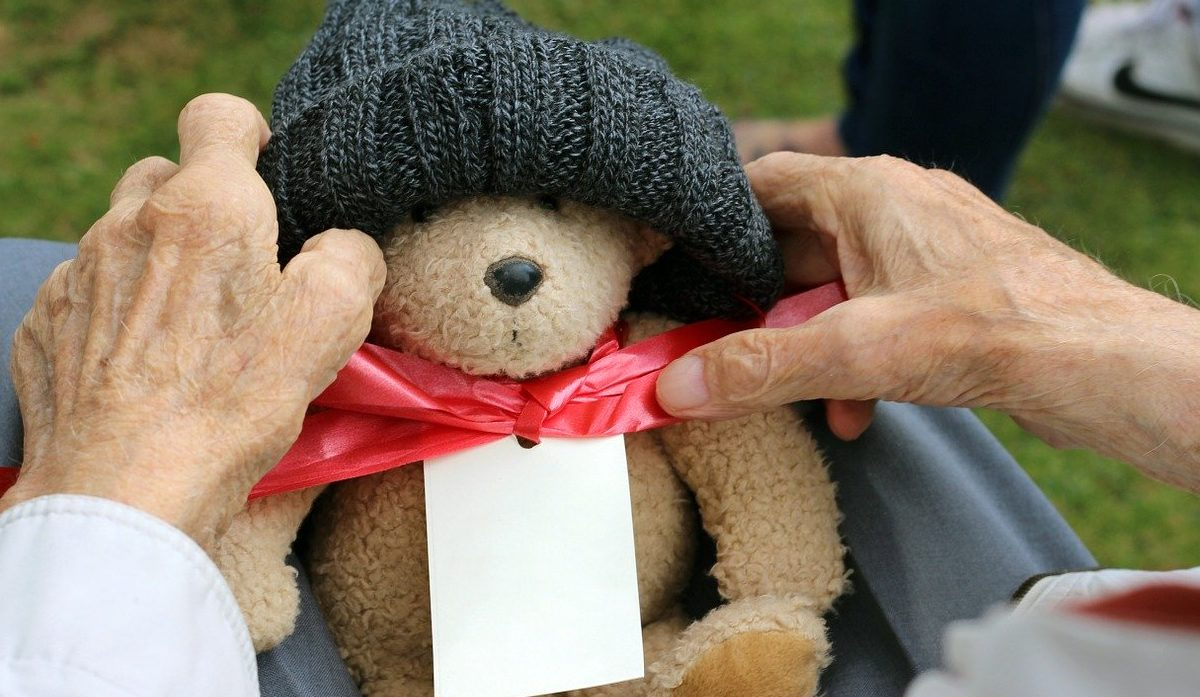 Older_man_holding_Teddy_Bear